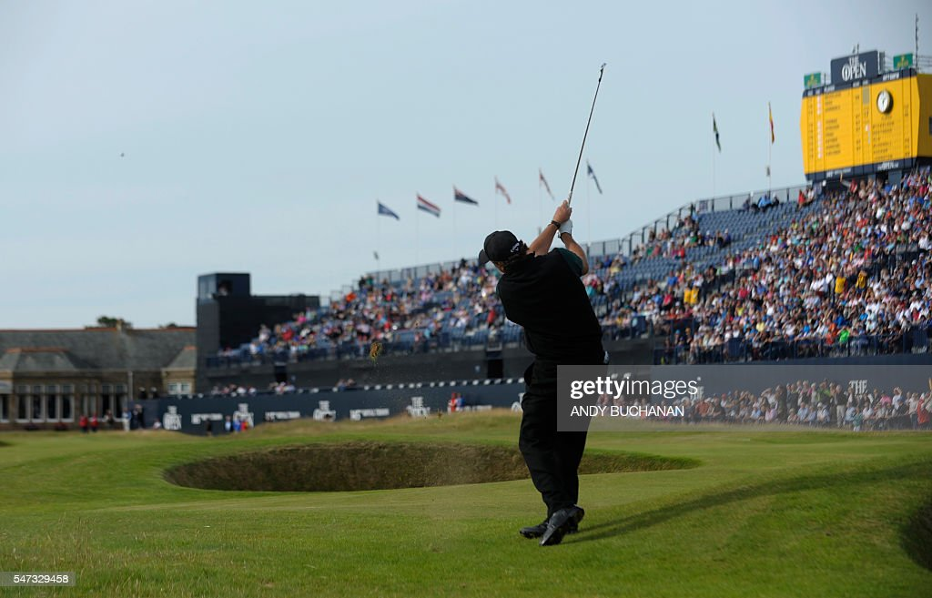US golfer Phil Mickelson plays towards the 18th Green during his first round 63 on the opening day of the 2016 British Open Golf Championship at Royal Troon in Scotland on July 14, 2016. Former champion Phil Mickelson went clear at the top of the leaderboard at the British Open on Thursday after a stunning eight-under-par first round of 63 at Royal Troon. USE