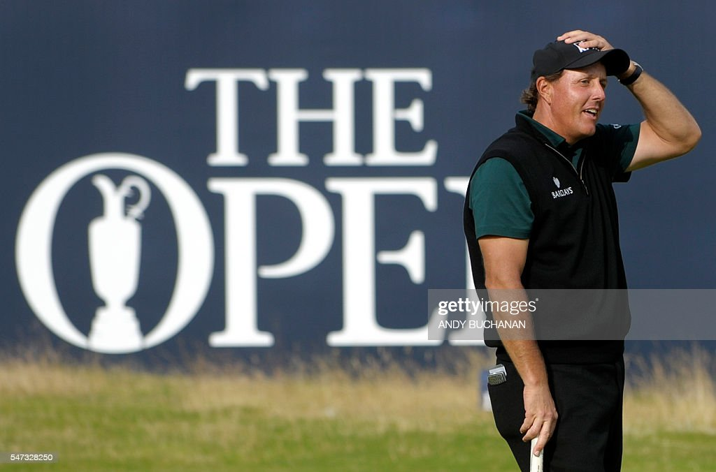 US golfer Phil Mickelson reacts after missing a putt on the 18th hole during his first round 63 on the opening day of the 2016 British Open Golf Championship at Royal Troon in Scotland on July 14, 2016. Former champion Phil Mickelson went clear at the top of the leaderboard at the British Open on Thursday after a stunning eight-under-par first round of 63 at Royal Troon. USE