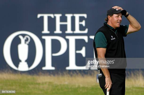 US golfer Phil Mickelson reacts after missing a putt on the 18th hole during his first round 63 on the opening day of the 2016 British Open Golf...