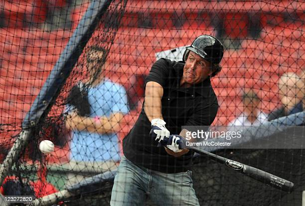 Golfer Phil Mickelson takes in some batting practice prior to the Boston Red Sox/New York Yankees game at Fenway Park on September 1 2011 in Boston...