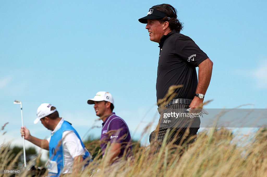 US golfer Phil Mickelson walks from seventh tee at Muirfield golf course at Gullane in Scotland on July 15, 2013 ahead of The 2013 Open Golf Championship. AFP PHOTO/Peter MUHLY