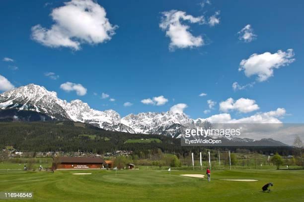 A golfer plays a shot on the golf course Wilder Kaiser on April 15 2011 in Going Austria Going is located next to the mountain of Wilder Kaiser and...