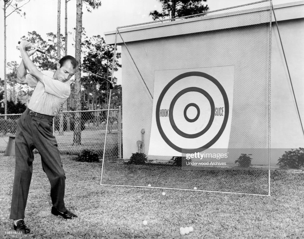 A golfer practicing his hooks and slices, mid 1950s.