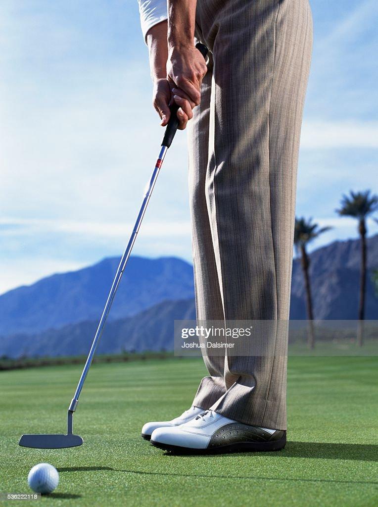 Golfer putting : Stock Photo