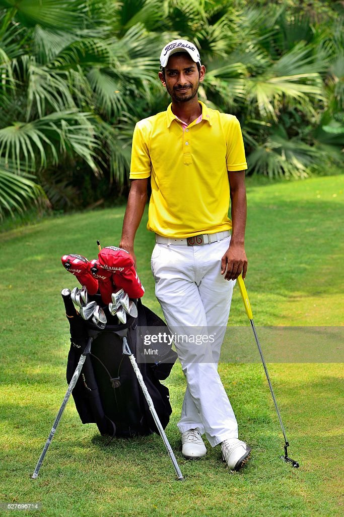 Golfer Rashid Khan poses for a profile shoot in Delhi Golf Club on August 18, 2015 in New Delhi, India.