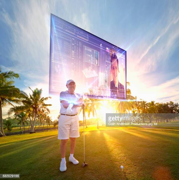 Golfer reading hologram screen on golf course