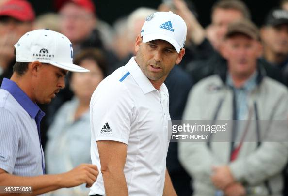 US golfer Rickie Fowler and Spain's Sergio Garcia walk from the 1st tee during their third rounds on day three of the 2014 British Open Golf...