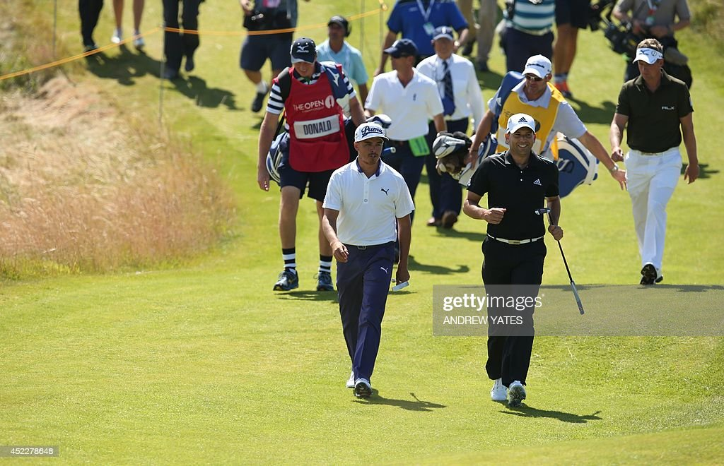 US golfer Rickie Fowler and Spain's <a gi-track='captionPersonalityLinkClicked' href=/galleries/search?phrase=Sergio+Garcia+-+Golfer&family=editorial&specificpeople=167240 ng-click='$event.stopPropagation()'>Sergio Garcia</a> (R) walk to the 13th tee during their first rounds, on the opening day of the 2014 British Open Golf Championship at Royal Liverpool Golf Course in Hoylake, north west England on July 17, 2014. AFP PHOTO / ANDREW YATES