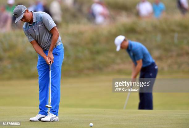 US golfer Rickie Fowler and US golfer Jordan Spieth putt on the 14th green during a practice round at Royal Birkdale golf course near Southport in...