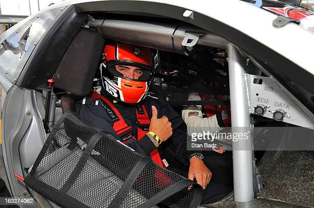 PGA golfer Rickie Fowler gives a thumbs up before taking a ride in a Cadillac CTSV race car driven by Andy Pilgrim with Team Cadillac around the...