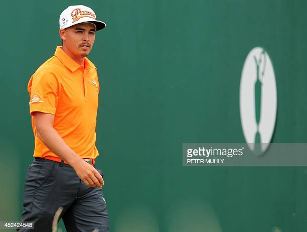 US golfer Rickie Fowler leaves the 1st tee during his fourth round on the final day of the 2014 British Open Golf Championship at Royal Liverpool...