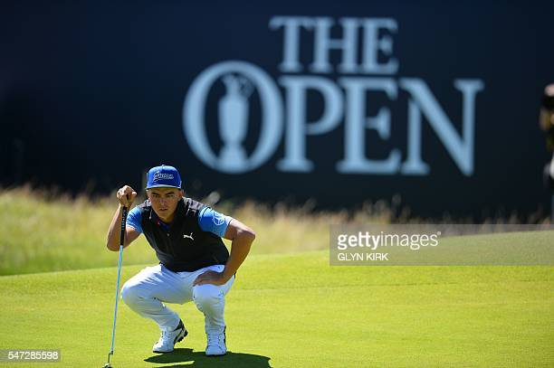 US golfer Rickie Fowler lines up a putt on the 18th Green during his first round 69 on the opening day of the 2016 British Open Golf Championship at...