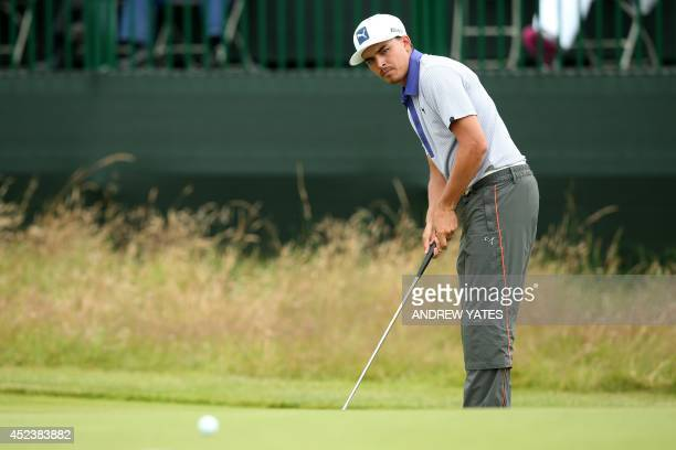 US golfer Rickie Fowler putts on the 11th green during his third round 68 on day three of the 2014 British Open Golf Championship at Royal Liverpool...