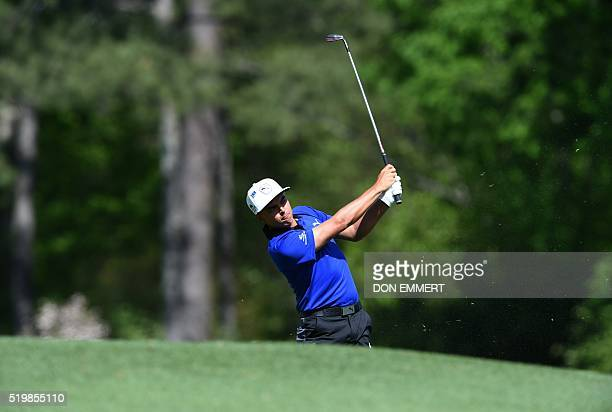 US golfer Rickie Fowler tees off on the 12th hole during Round 2 of the 80th Masters Golf Tournament at the Augusta National Golf Club on April 8 in...