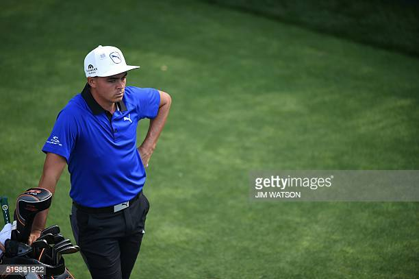 US golfer Rickie Fowler waits to play his shot during Round 2 of the 80th Masters Golf Tournament at the Augusta National Golf Club on April 8 in...