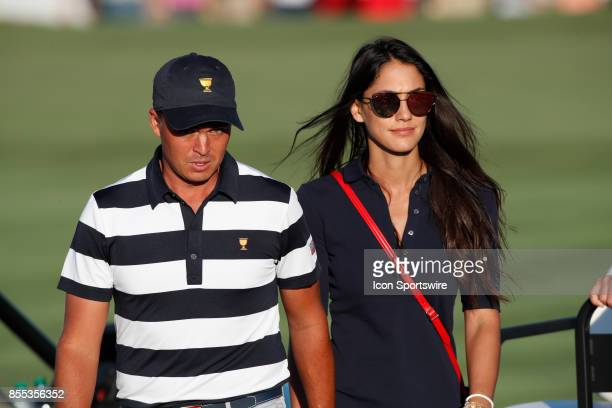 USA golfer Rickie Fowler with his girlfriend Allison Stokke walk the 15th hole together during the first round of the Presidents Cup on September 28...