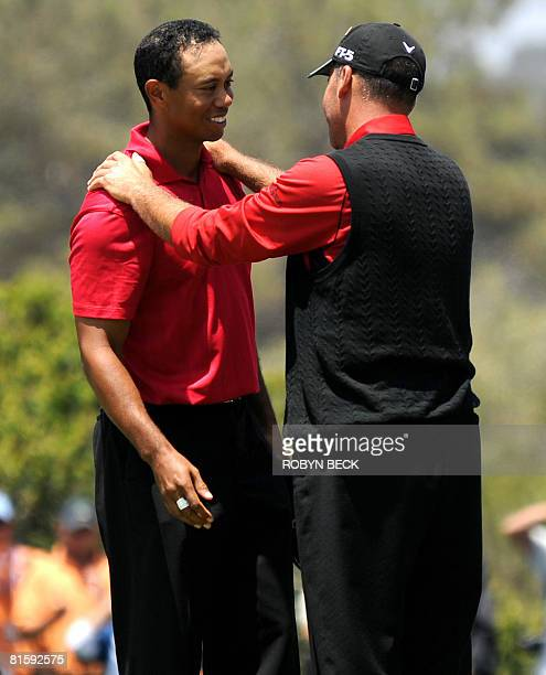 US golfer Rocco Mediate congratulates compatriot Tiger Woods on the first hole of sudden death of the playoff after Mediate missed his putt give...