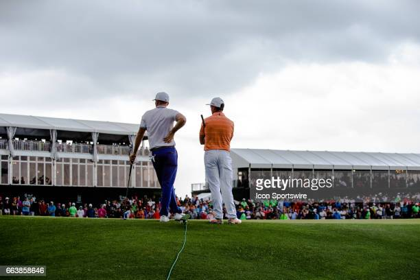 PGA golfer Russell Henley and Rickie Fowler standing on the 18th green Shell Houston Open on April 02 2017 at Golf Club of Houston in Humble TX