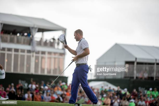 PGA golfer Russell Henley waves to the crowd on the 18th green after winning the Shell Houston Open on April 02 2017 at Golf Club of Houston in...