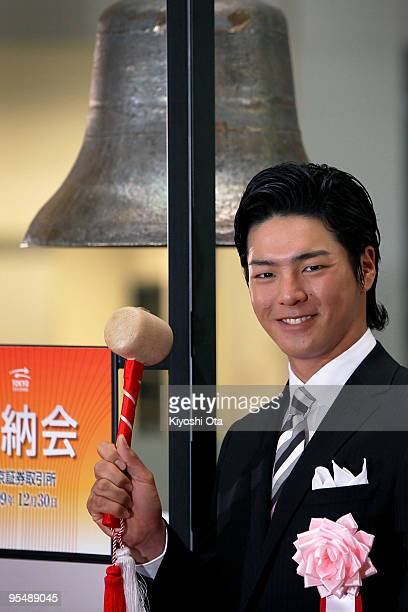 Golfer Ryo Ishikawa poses before ringing a bell during the closing ceremony to mark the end of the year's trading at the Tokyo Stock Exchange on...