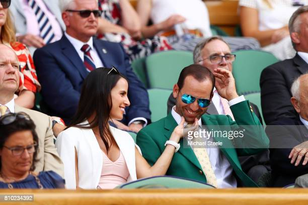 Golfer Sergio Garcia and fiancee Angela Akins look on from the centre court royal box on day five of the Wimbledon Lawn Tennis Championships at the...