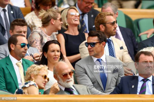 Golfer Sergio Garcia Dan Carter and wife Honor Carter look on from the centre court royal box on day five of the Wimbledon Lawn Tennis Championships...