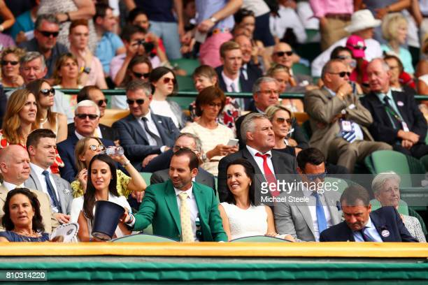 Golfer Sergio Garcia his fiancee Angela Akins Dan Carter and wife Honor Carter look on from the centre court royal box on day five of the Wimbledon...