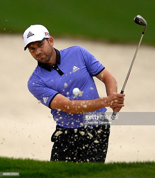 Golfer Sergio Garcia hits from a bunker along the 10th green on Tuesday April 7 2015 at Augusta National Golf Club in Augusta Ga Garcia and other...