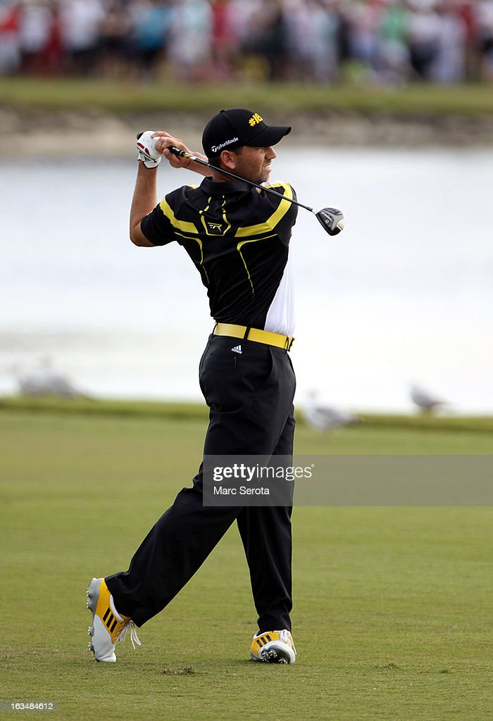 Golfer Sergio Garcia hits on the eighteenth fairway at the World Golf Championships-Cadillac Championship at the Trump Doral Golf Resort & Spa on March 10, 2013 in Doral, Florida.