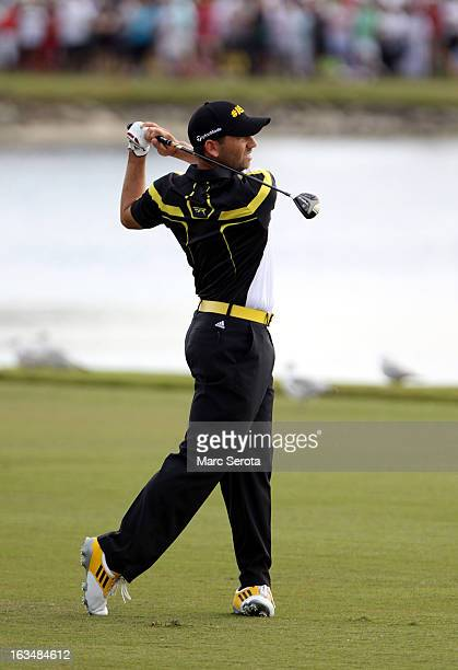 Golfer Sergio Garcia hits on the eighteenth fairway at the World Golf ChampionshipsCadillac Championship at the Trump Doral Golf Resort Spa on March...