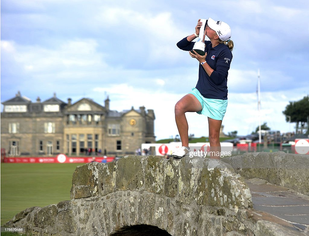 US golfer Stacy Lewis kisses the trophy on the Swilcan Bridge after winning the women's British Open Golf Championship at the Old Course in St Andrews, Scotland, on August 4, 2013. US golfer Stacy Lewis won the women's British Open on Sunday by two shots. Lewis, the winner of the 2011 Kraft Nabisco Championship, collected her second major with a final round 72 for an eight-under-par total of 280.