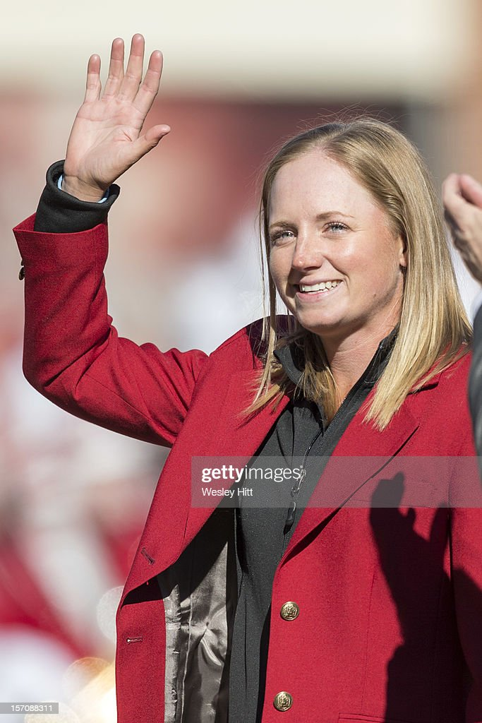 LPGA golfer <a gi-track='captionPersonalityLinkClicked' href=/galleries/search?phrase=Stacy+Lewis+-+Golfer&family=editorial&specificpeople=4217318 ng-click='$event.stopPropagation()'>Stacy Lewis</a> of the Arkansas Razorbacks is honored before a game against the LSU Tigers at Razorback Stadium on November 23, 2012 in Fayetteville, Arkansas. The Tigers defeated the Razorbacks 20-13.
