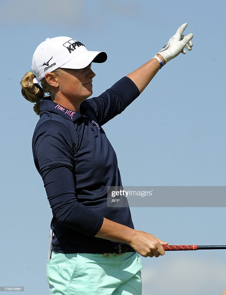 US golfer Stacy Lewis watches her tee shot from the 12th tee during the final round of the women's British Open Golf Championship at the Old Course in St Andrews, Scotland, on August 4, 2013. US golfer Stacy Lewis won the women's British Open on Sunday by two shots. Lewis, the winner of the 2011 Kraft Nabisco Championship, collected her second major with a final round 72 for an eight-under-par total of 280. AFP PHOTO/ANDY BUCHANAN