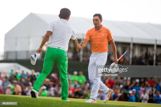 PGA golfer Sung Kang shakes hands with Rickie Fowler on the 18th green on the Shell Houston Open on April 02 2017 at Golf Club of Houston in Humble TX