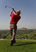Golfer Teeing Off at Phoenician Resort in Scottsdale