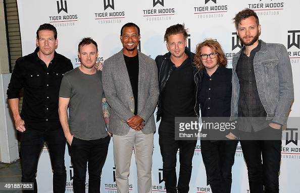 Golfer Tiger Woods and members of the band OneRepublic guitarist Zach Filkins drummer Eddie Fisher singer Ryan Tedder guitarist Drew Brown and...