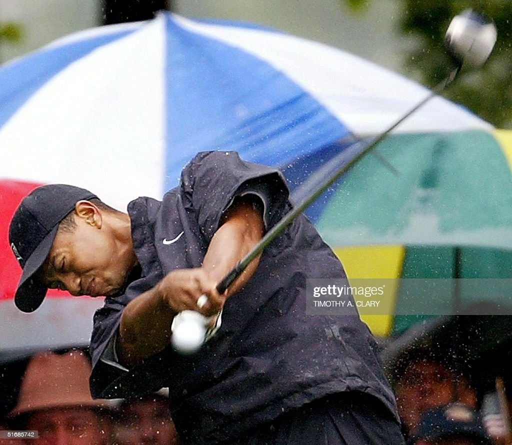 US golfer Tiger Woods drives his ball off of the 10th tee during the second round at the 102nd US Open Championship 14 June 2002 at Bethpage State...