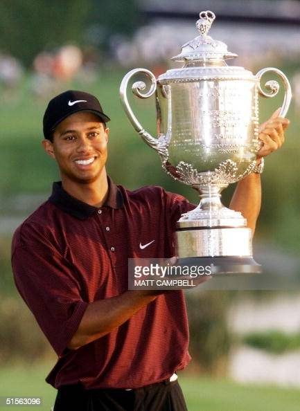 Golfer Tiger Woods of the US holds the Wanamaker trophy 20 August 2000 after winning the 82nd PGA Championship at Valhalla Golf Club in Louisville KY...