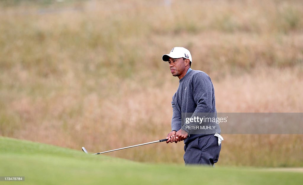US golfer Tiger Woods plays from the rough on the 16th fairway during a practice round for the 2013 British Open Golf Championship at Muirfield Golf Course in Gullane, eastern Scotland, on July 15, 2013 ahead of the 2013 Open Golf Championship. Woods said that he was ready for the British Open and an elbow injury won't be a problem when the year's third major championship starts July 18 at Muirfield.