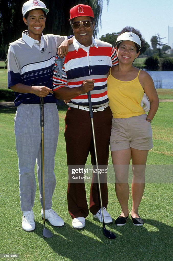 Golfer Tiger Woods poses for a photograph with his mother and father Earl and Kultida Woods on September 22, 1990.