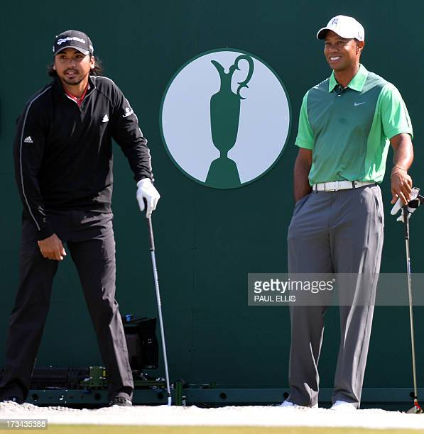 US golfer Tiger Woods stands with Australian golfer Jason Day on the first tee during a practice round for the 2013 British Open Golf Championship at...