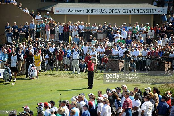 US golfer Tiger Woods tees off on the first hole in the playoff against compatriot Rocco Mediate at the 108th US Open golf tournament at Torrey Pines...