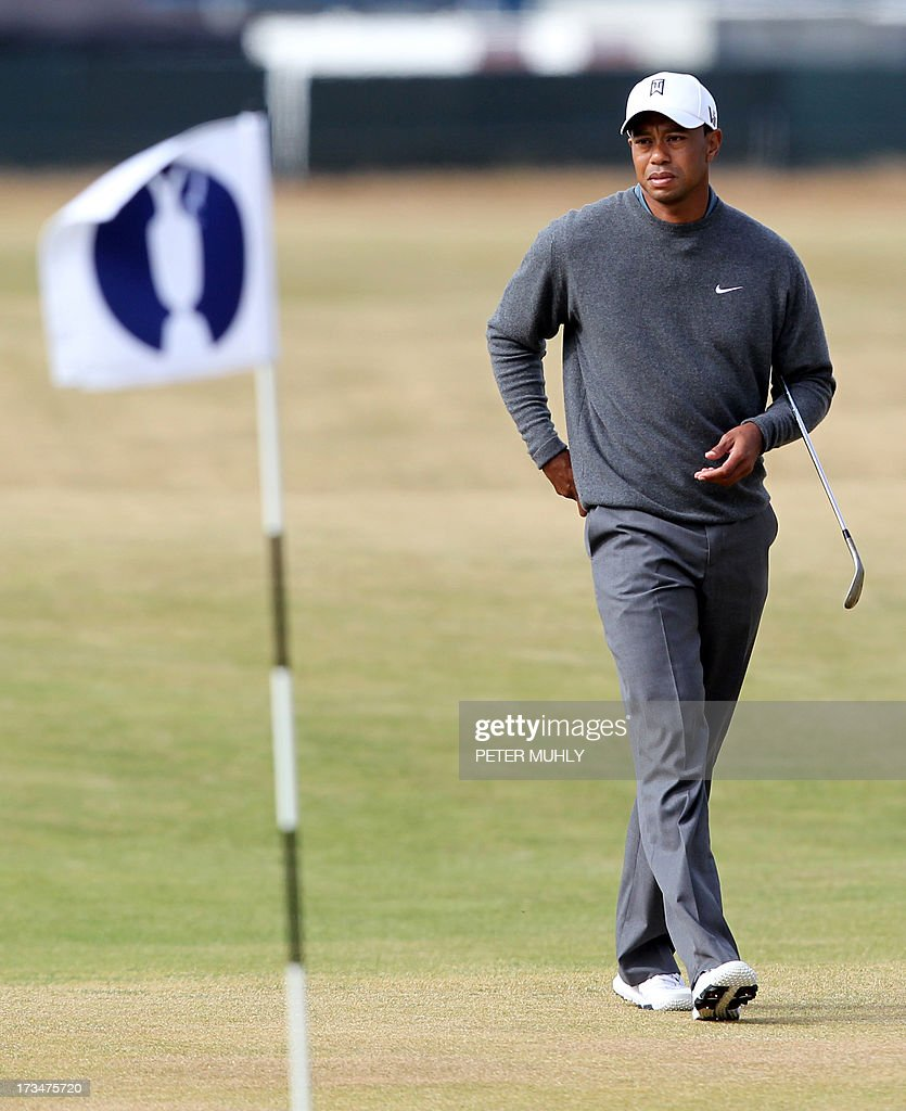 US golfer Tiger Woods walks across the 16th fairway during a practice round for the 2013 British Open Golf Championship at Muirfield Golf Course in Gullane, eastern Scotland, on July 15, 2013 ahead of the 2013 Open Golf Championship. Woods said that he was ready for the British Open and an elbow injury won't be a problem when the year's third major championship starts July 18 at Muirfield.