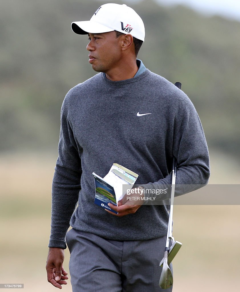 US golfer Tiger Woods walks across the 17th green during a practice round for the 2013 British Open Golf Championship at Muirfield Golf Course in Gullane, eastern Scotland, on July 15, 2013 ahead of the 2013 Open Golf Championship. Woods said that he was ready for the British Open and an elbow injury won't be a problem when the year's third major championship starts July 18 at Muirfield.