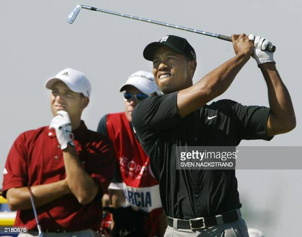 US golfer Tiger Woods watches the flight of his tee shot together with Spanish golfer Sergio Garcia on the 9th green on the second day at The Open...