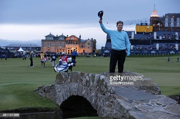 US golfer Tom Watson poses on the Swilcan Bridge as he marks his final round in any British Open on day two of the 2015 British Open Golf...