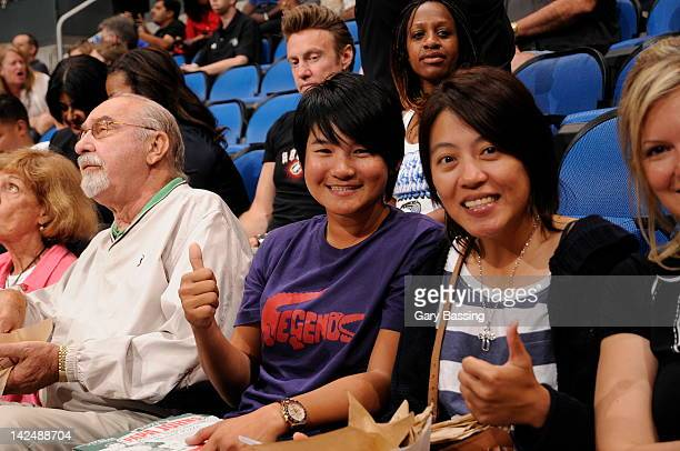 Golfer Yani Tseng center currently ranked first in the Women's World Golf Rankings attends the game between the New York Knicks and the Orlando Magic...