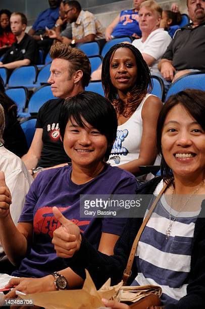 Golfer Yani Tseng left currently ranked first in the Women's World Golf Rankings attends the game between the New York Knicks and the Orlando Magic...