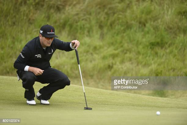 US golfer Zach Johnson lines up a putt on the 6th green during his second round on day two of the Open Golf Championship at Royal Birkdale golf...