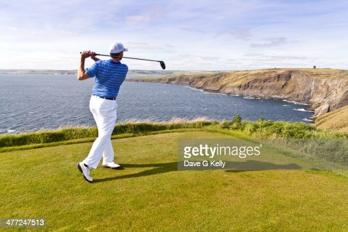 Golfer's Cliff Face Drive : Stock Photo